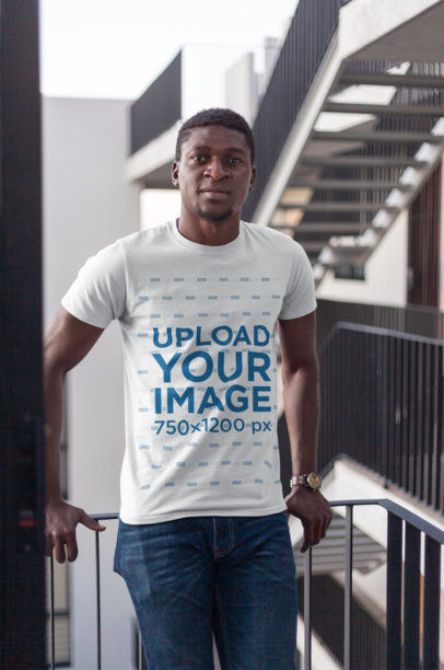 T-Shirt Mockup of a Man Posing Casually in a Building with Stairways 26645