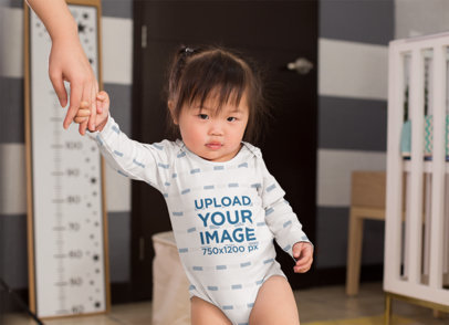 Onesie Mockup of a Baby Girl Holding Her Mom's Hand 25138