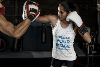 Tank Top Mockup of a Female MMA Wrestler Hitting a Training Pad 26235