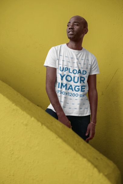 T-Shirt Mockup of a Man Standing in a Colorful Stairway 26318