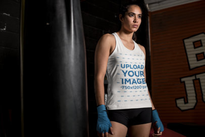 Tank Top Mockup of a Female MMA Fighter Standing by a Punching Bag 26257