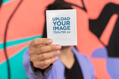 Mockup of a Woman Covering Her Face with a Polaroid Frame 26290