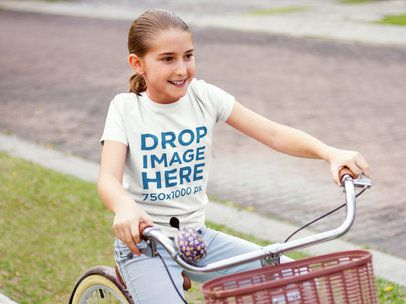 Girl Learning How to Ride a Bicycle T-Shirt Mockup a7929
