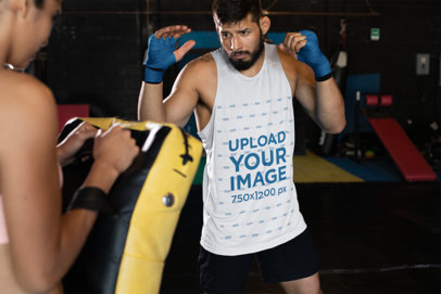 Tank Top Mockup of an MMA Fighter Hitting a Dummy 25234