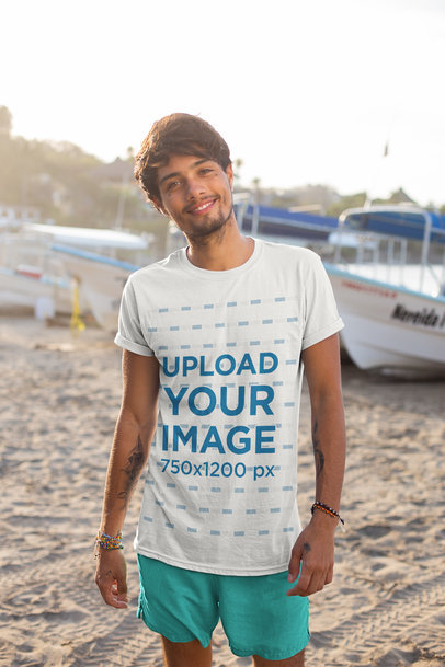 T-Shirt Mockup of a Slim Tattooed Man at the Beach  26751
