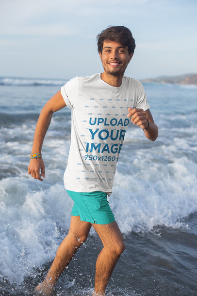 T-Shirt Mockup of a Young Man Playing in the Waves