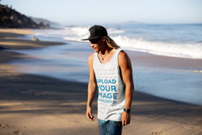 Tank Top Mockup of a Blonde Long-Haired Man with a Cap by the Beach 26840