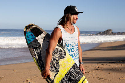 Tank Top Mockup of a Young Man Carrying a Surfboard at the Beach 26843