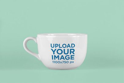 Mockup of a Large Coffee Mug with a Colored Backdrop 26466