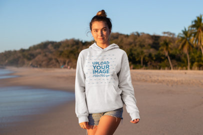 Hoodie Mockup of a Pretty Girl at a Sun-Setting Beach 26806