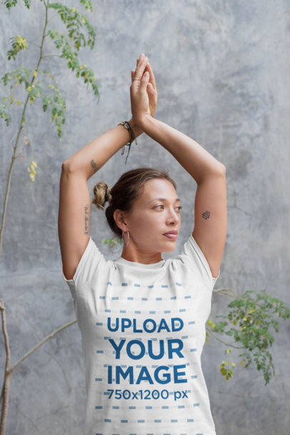 Mockup of a Yoga Teacher Wearing a Tee While in a Pose