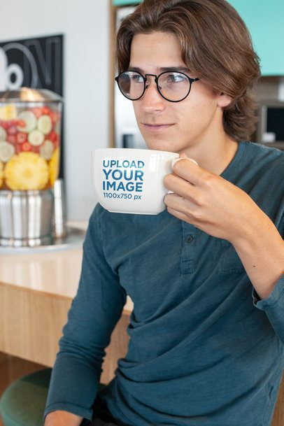 Coffee Mug Mockup of a Young Man with Glasses by a Juice Bar 26502