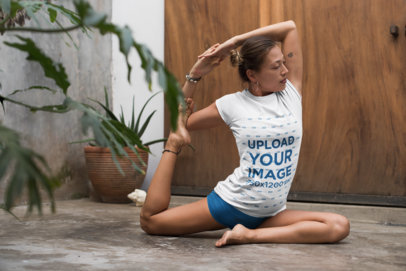 Tee Mockup of a Woman with a Hair Bun Doing Yoga