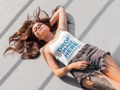 Young Tattooed Woman Lying on the Floor Tank Top Mockup a5707