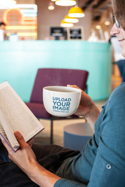 24 oz Mug Mockup of a Man Reading a Book at a Coffee Shop