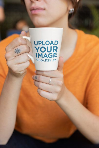 Coffee Mug Mockup Featuring a Finger-tattooed Lady with an Orange Blouse 26447