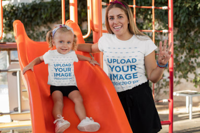 T-Shirt Mockup of a Little Girl and Her Mom Having Fun at a Playground 26499