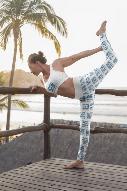 Mockup of a Woman With a Sports Bra and Leggings Stretching by the Beach 26856