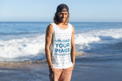 Tank Top Mockup of a Man Posing in Front of the Waves 26748