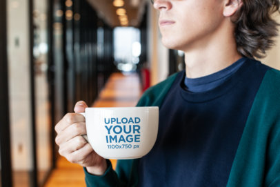 Coffee Mug Mockup of a Young Man in a Hallway 26511