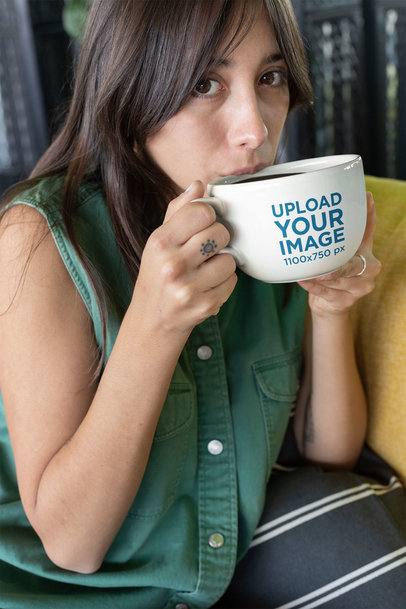 Mockup of a Dark-Haired Girl Drinking from a Big Coffee Mug 26461