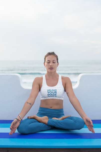 Mockup of a Meditating Woman in Sports Bra and Leggings