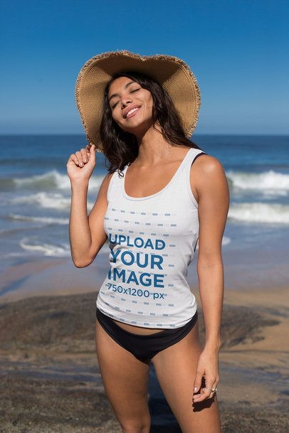 Tank Top Mockup of a Young Woman with a Floppy Hat at the Beach 26771