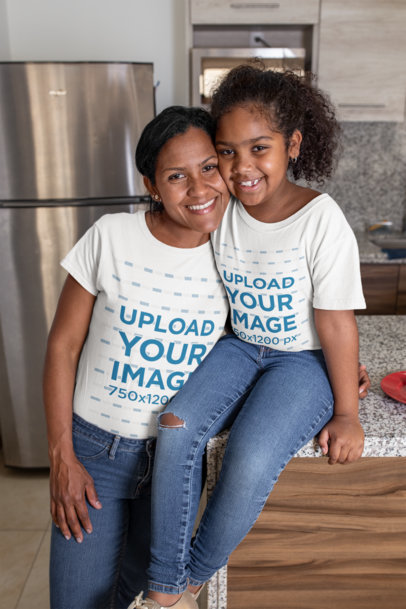 Tee Mockup of a Mom Hugging Her Daughter at Their Home's Kitchen 26384
