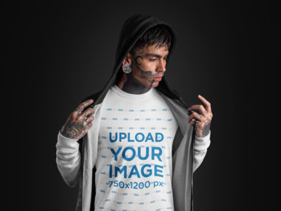 Mockup of a Goth Man with Tattoos on His Face Wearing a T-Shirt Under a Hoodie 26595
