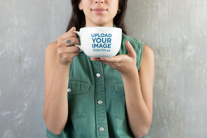 Coffee Mug Mockup Featuring a Woman Against a Concrete Wall 26462