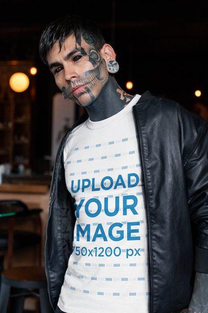 T-Shirt Mockup of a Goth Man with a Tattooed Face and a Leather Jacket 26606