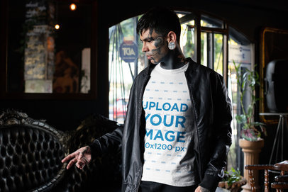 T-Shirt Mockup of a Goth Man with a Tattooed Face and Piercings Wearing a Jacket 26868