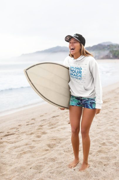 Pullover Hoodie Mockup of a Joyful Young Woman at the Beach Carrying a Surfboard 26816