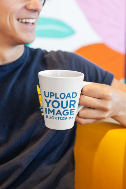 11 oz Coffee Mug Mockup of a Smiling Man in a Colorful Setting 26519