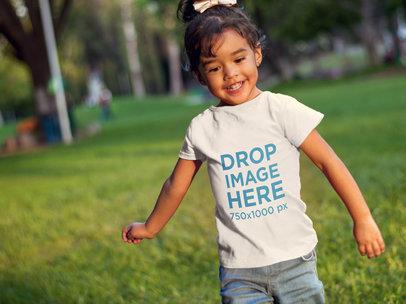 Little Girl Running at a Park T-Shirt Mockup a7679