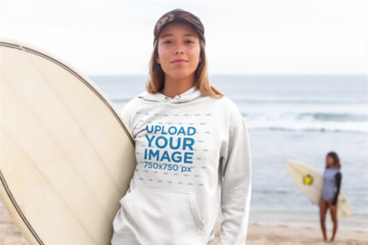 Pullover Hoodie Mockup of a Woman with a Surfboard Standing Against Beach Waves 26818