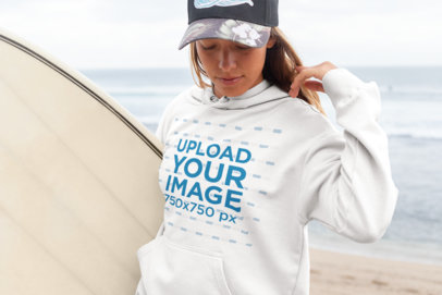 Pullover Hoodie Mockup of a Surfer Woman Carrying Her Board at the Beach 26825