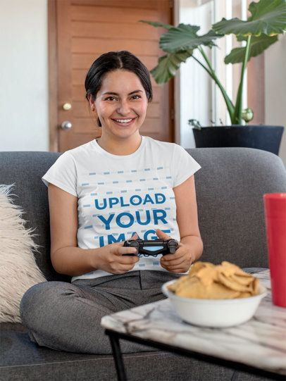 T-Shirt Mockup of a Gamer Woman Sitting Next to a Plate of Nachos 26997