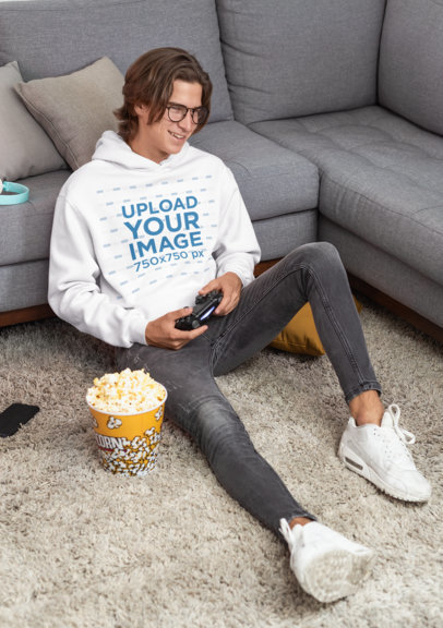 Hoodie Mockup of a Young Man with Glasses Playing Video Games 26907
