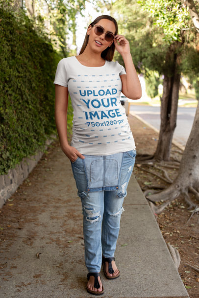 T-Shirt Mockup of a Pregnant Woman Wearing Overalls on the Street 26664