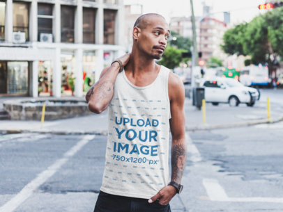 Mockup of a Buzz-Cut Man Wearing a Tank Top by the Street 23998