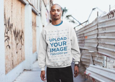 Mockup of a Serious Man Wearing a Heathered Sweatshirt in an Alley  24003
