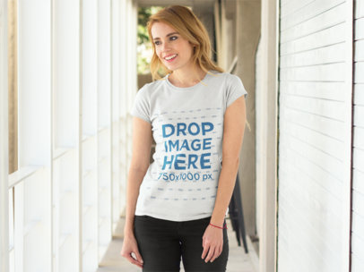 Woman Standing in a Hallway T-Shirt Mockup a8133