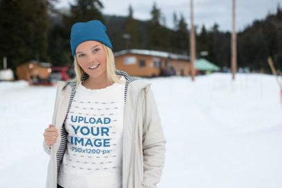 Sweatshirt Mockup of a Woman Wearing a Coat in the Snow 25082