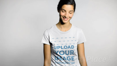 T-Shirt Video of a Smiling Woman Against a White Wall 13616
