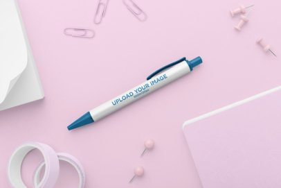 Mockup of a Pen Surrounded by Office Supplies 23530