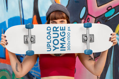 Mockup of a Woman Holding a Skateboard Against a Graffiti 27113