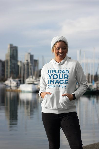 Hoodie Mockup of a Happy Woman Standing at a City Pier 25095