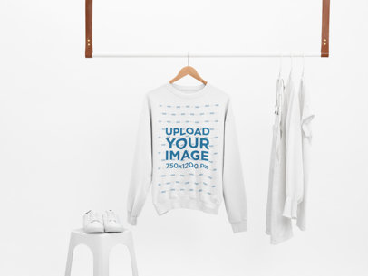Mockup of a Sweatshirt Hanging With Only White Clothes 26892