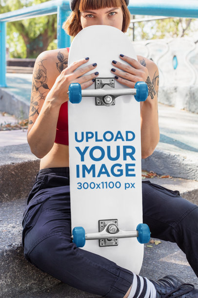 Skateboard Mockup Featuring a Tattooed Skater Woman  27112